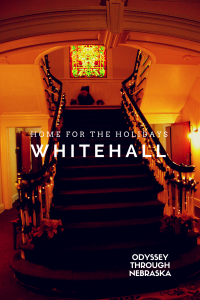 Lincoln's Whitehall Mansion's grand staircase at Christmastime